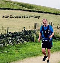 Photo of Jog'on Buddy running at mile 25 and still smiling