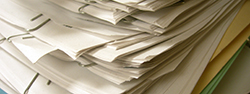 pile of papers held with paper clips